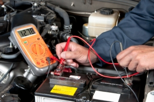 Auto mechanic checking car b